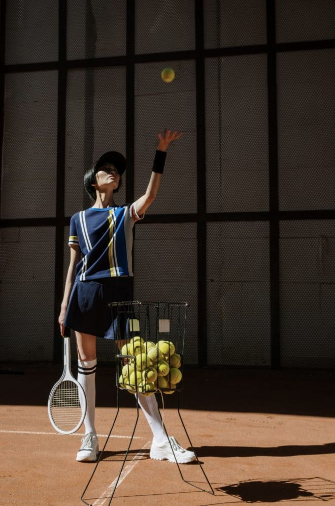 a_lady_playing_tennis