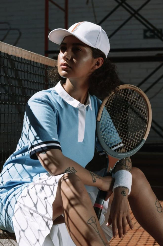 nice_looking_girl_with_tennis_rocket_and_tennis_dress