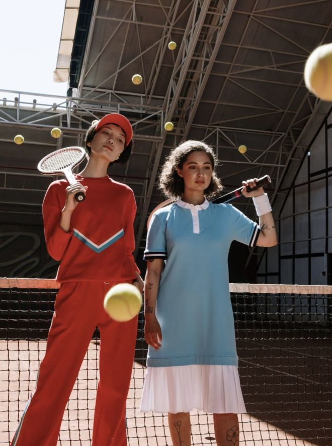 two_ladies_with_tennis_rocket_and_balls