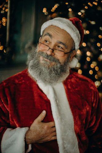 Weihnachtsmann bei einer Fotosession